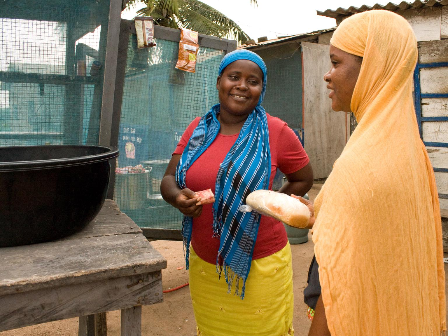 A market stall owner talks to a customer